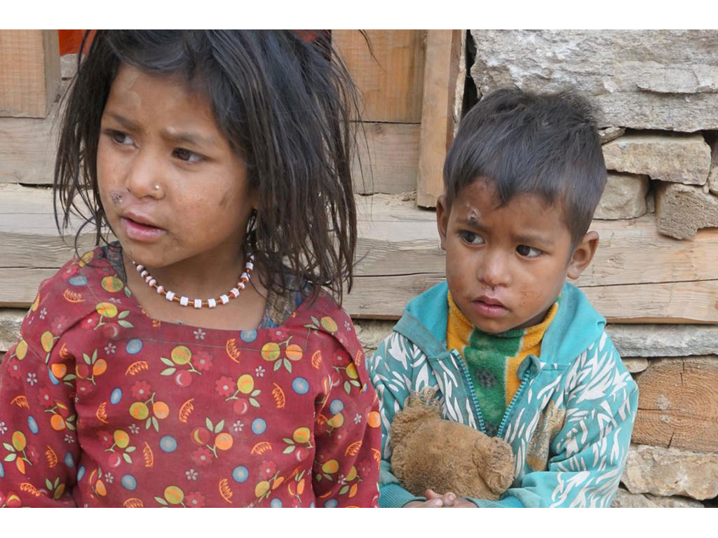 A boy and a girl in Simikot, Nepal. Mahila Avaz - Women's Voice aims to create equality between boys and girls and men and women.