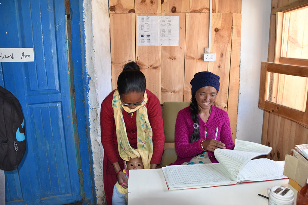 Two midwives, who were educated and paid by the association Nepal Trust Austria, writng down births into the birth book.